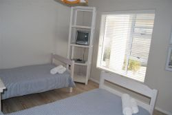 Twin Bedroom with shared bathroom and small entertainment system
