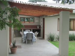 Covered patio and braai provide a great place to socialise