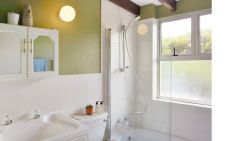 En-suite bathroom with a shower over the bath. Toiletries are provided.