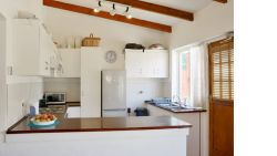 Fully equipped kitchen is available for use and is shared with the household.