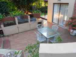 braai area accessed from lounge by sliding doors. Just round the corner from pool and deck