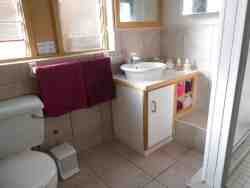 bathroom, accessed from dressing area.