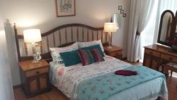 Relax in our Queen Sized Main Bed with own en-suite Bathroom . walks out on private patio