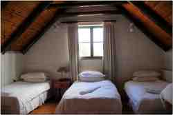 Our loft room with three single beds ideal for a family break away.