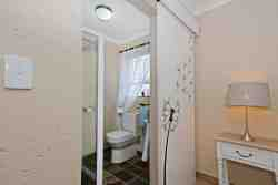 Dandelion room bathroom with shower.