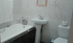 Ground floor second bathroom, has bath toilet and basin