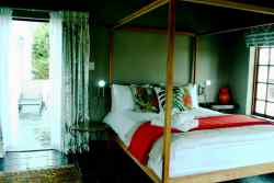 Our Protea Suite also has a small anteroom for extra single beds. All our rooms have a private outdoor balcony or patio
