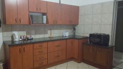 This is our interlinking sharing unit's fully functional kitchen. There are also an outside braai combined with this unit.