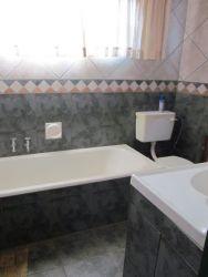 Bathroom with bath and shower