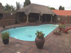 Swimming pool and lapa for breakfast, lunch, dinner and braai