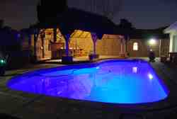 Pool and lape in the evening/night