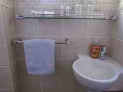 The bathroom has a shower, basin and toilet.  Shower gel and and shampoo is provided as well as fresh towels.
