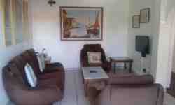 Lounge with flat screen TV and full DSTV, Cottage A