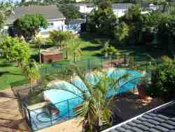 tropical garden with solar-heated swimming-pool and jacuzzi