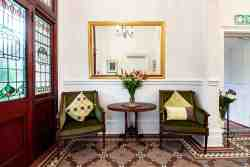 Behind a large double stained glass door, you will walk into the entrance hall, leading to the Reception desk. The original Victorian tiled floor adds to the well preserved character of the mansion.