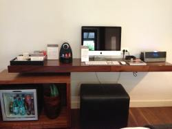 An Apple Mac and a Nesspresso machine in every room