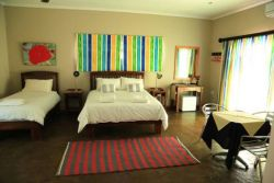 Room 7 with a queen size bed and a single bed and a sleeper couch for kids up to 5 yrs old.