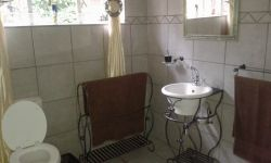 Second Bathroom with shower, basin and toilet sharing