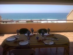 Spectacular sea views from spacious balcony equipped with built-in braai