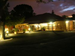 Night view of Dempsey's Guest House