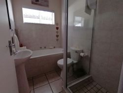 Unit 3 & 4 - STRELITZIA AND CLIVIA bathroom - Shower only, basin and toilet