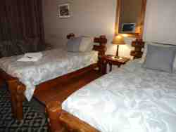 Room 9 - 3 single beds sharing with shower and smoking area outside