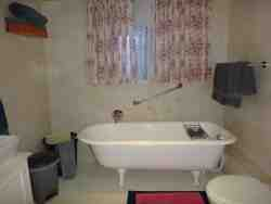 Drievis Full-on bathroom with antique free standing bath and shower