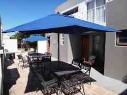 Sun deck and patio furniture and BBQ area