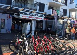 Surf shop and bike rental at Bay Beach