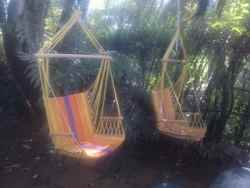 Hanging chairs in the garden corner