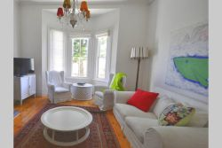 The bright sunny lounge with a beautiful bay window