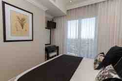 Bedroom 2 boasts a queen size bed with Juliette balcony with stunning views of V&A, Stadium and sea
