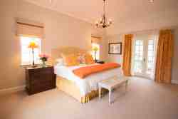 This room is situated Upstairs and has a Kingsize Bed.  This bedroom is very spacious and has French doors that lead onto a gorgeous balcony, overlooking the Knysna Lagoon and the beautiful gardens of Belvidere Manor.