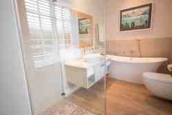The Master Bedroom has an ensuite with a beautiful free standing bath and separate shower.