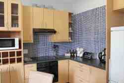 Fully equipped kitchen with stove, microwave, fridge, kettle, toaster and coffee machine