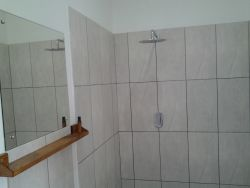 En suite shower, wash hand basin and loo