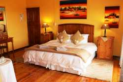 U1 Superior room, King & Single bed, Airconditioned, DSTV with en-suite Shower & Corner Spa Bath