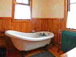 Romantic Victorian Bath plus outdoor shower (Copyright Forest Edge)
