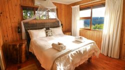 Rest in utter bliss on the queen sized bed, with luxury linens and the sound of nature surrounding