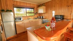 The Cabin has a fully equipped kitchen with cutlery and crockery, a fridge, a gas hob and oven, kettle, toaster and coffee making facilities.