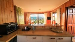The open plan kitchen also looks out over the incredible view!