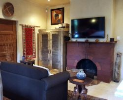 The Artistic Cove with extra sleeper couch, flat screen TV with satellite and built in fire place.