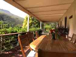 Stunning stoep at Sam's Place. Amazing views and music of the waterfall in the kloof...perfect place to relax!