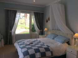 Main Queen bedroom looking onto Golf Course