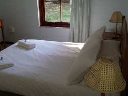 Sunbird Cottage has 2 cosy bedrooms that share a large bathroom with shower and bath