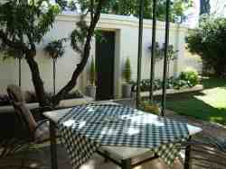 Entertaining area with Braai .Far right is entrance to under roof parking for 2 cars