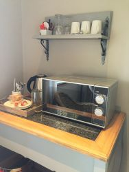 Coffee station with kettle, microwave and fridge available in all rooms