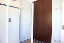 Walk-in rainshower; cupboard with fridge & digital safe