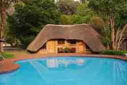 Thatched Rooms 7 & 8 at Swimming Pool