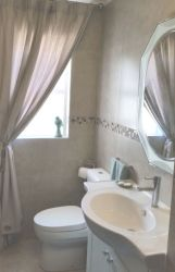 En-suite bathroom with shower.